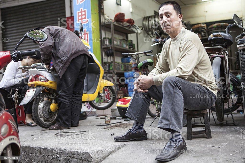 Motorcycle repair shop in Foshan City, China stock photo