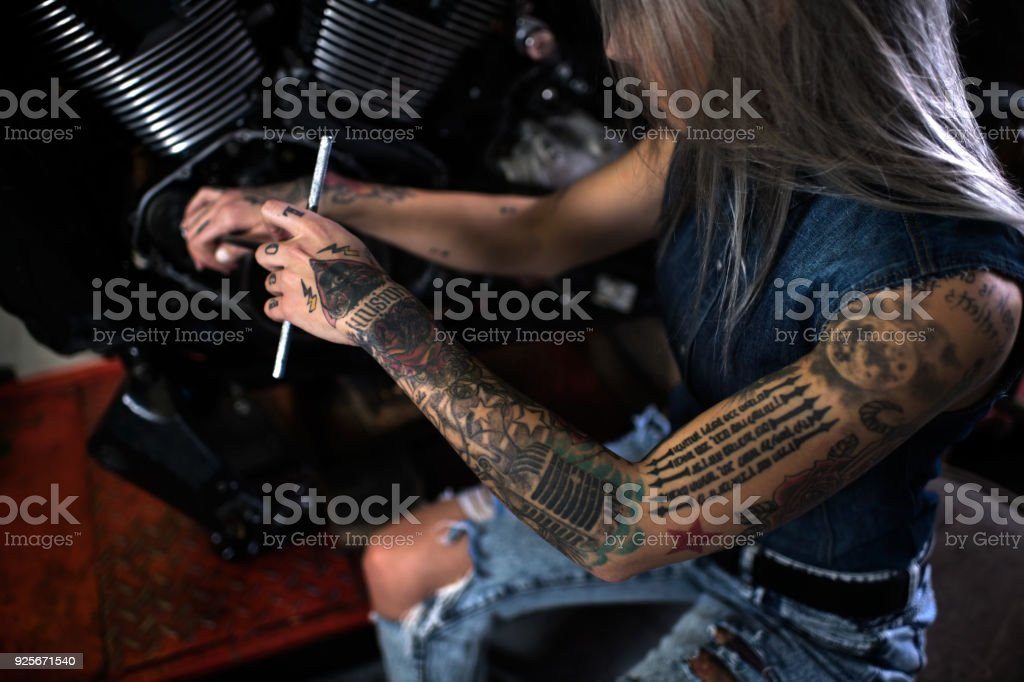 Motorcycle repair shop stock photo