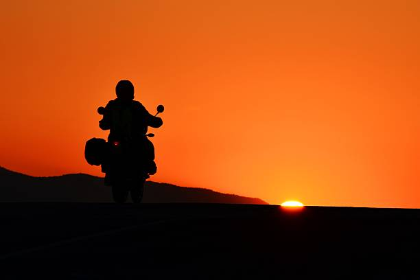Motorcycle Rider at Sunset stock photo