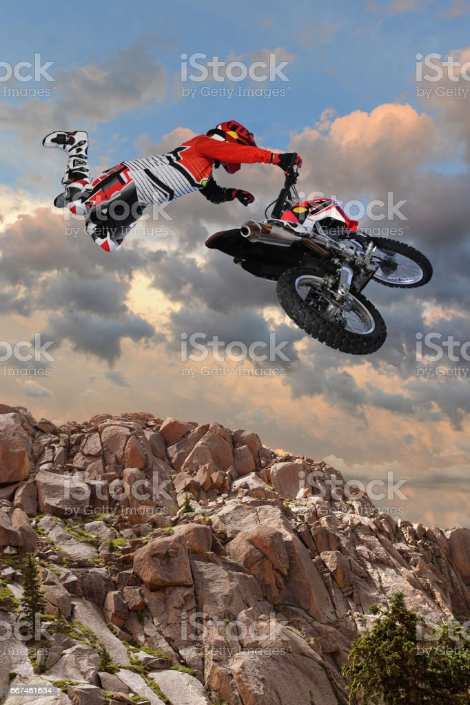 Motorcycle Rider Performing Aerial Stunt stock photo