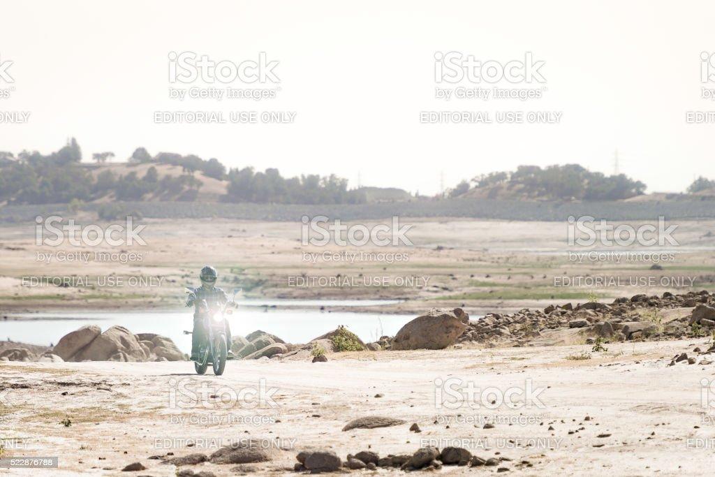 Motorcycle Rider Travels through Folsom Lake stock photo