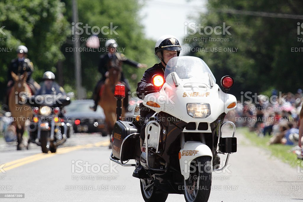 Motorcycle Sheriff Leading July 4th Parade stock photo