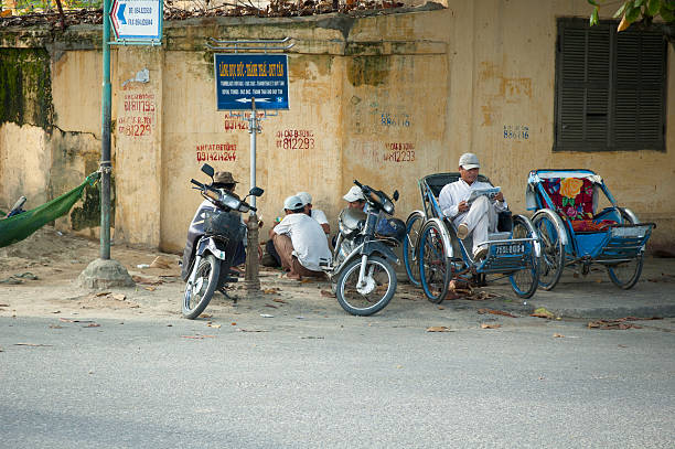 motorcycle taxi and rickshaw drivers wait for customers in hue - motorbike, umbrella stock photos and pictures