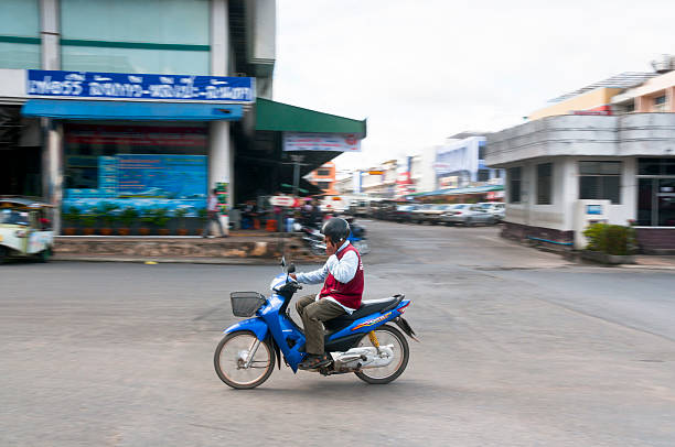 motorcycle taxi driver in thailand - motorbike, umbrella stock pictures, royalty-free photos & images