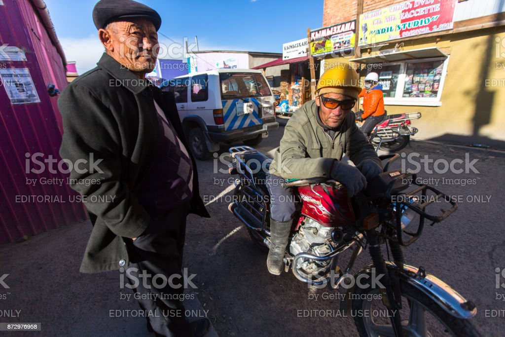Motorcycle taxi driver waiting for customers near the city market. stock photo