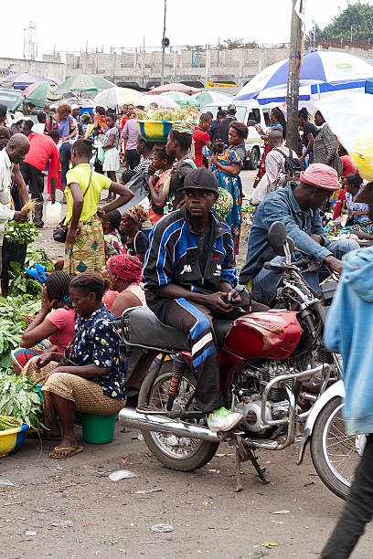 motorcycle taxi in drc, africa - democratic republic of the congo stock photos and pictures