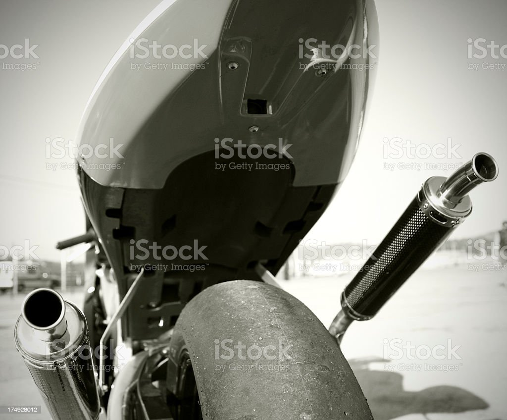 Motorcycle tire and exhaust royalty-free stock photo