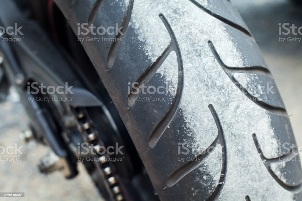 Motorcycle tire rubber  back wheel stain stock photo