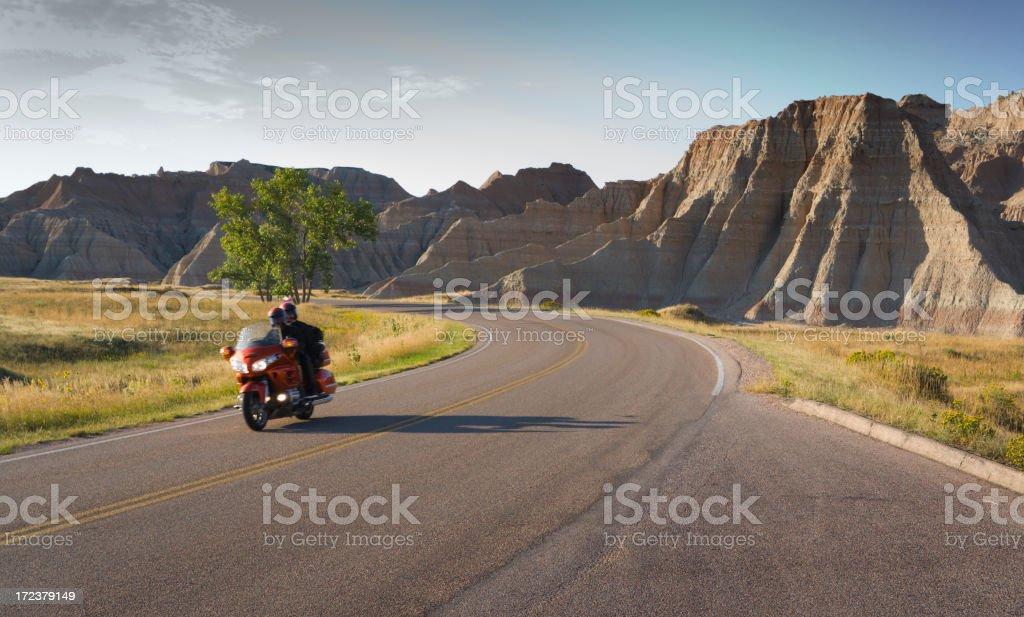 Motorcycle Touring, Biker Riding in Badlands South Dakota Landscape stock photo