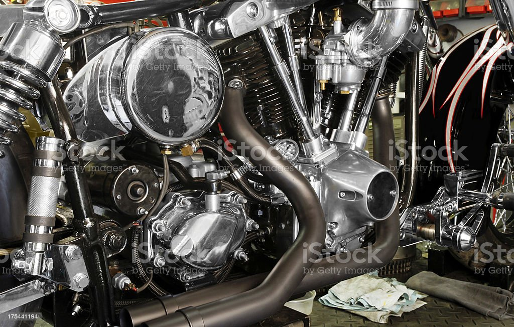 Motorcycle under construction in home garage.  Horizontal. royalty-free stock photo