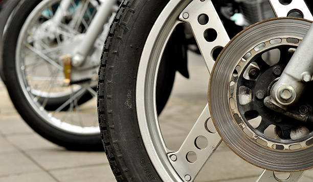 Motorcycle wheel motocycle wheel and disc break three wheel motorcycle stock pictures, royalty-free photos & images