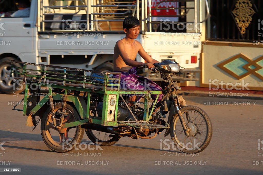 Motorcycle with a sidecar in Myanmar stock photo