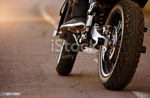 Motorcycle with biker on the asphalt road. Motorbike traveling concept.