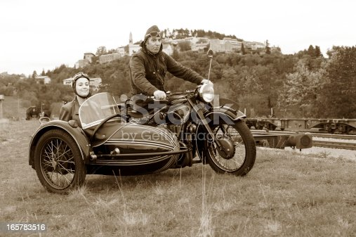 Road trip with a vintage motorcycle and sidecar. Desatured and toned image. Štanjel, Slovenia, Europe.