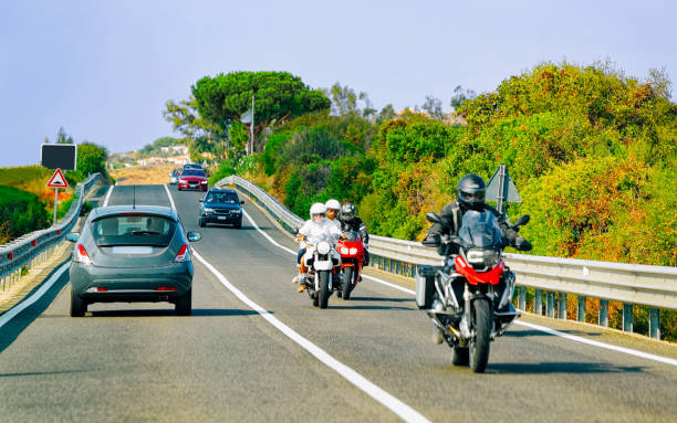 Motorcycles and cars in road in Costa Smeralda reflex stock photo