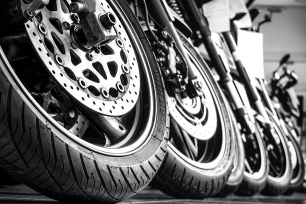 Motorcycles front wheels in a row stock photo