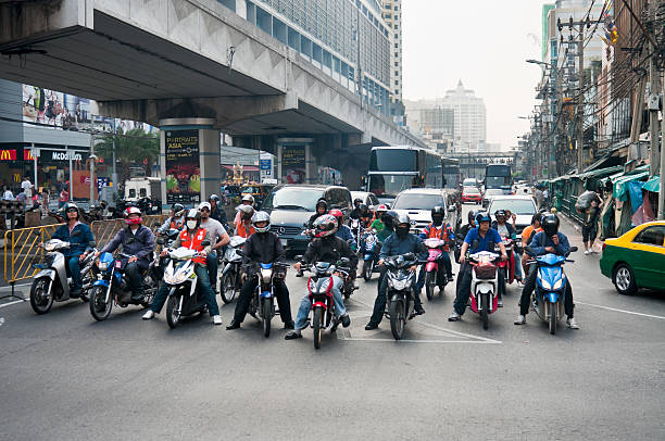 motorcycles in busy traffic - motorbike, umbrella stock pictures, royalty-free photos & images