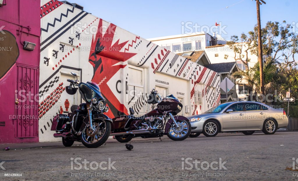 Motorcycles in the parking lot on colorful Venice Beach stock photo