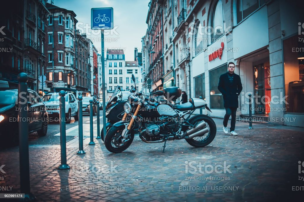Motorcycles parked on the vintage streets stock photo