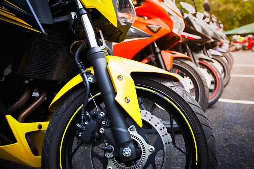 motorcycles standing in the row