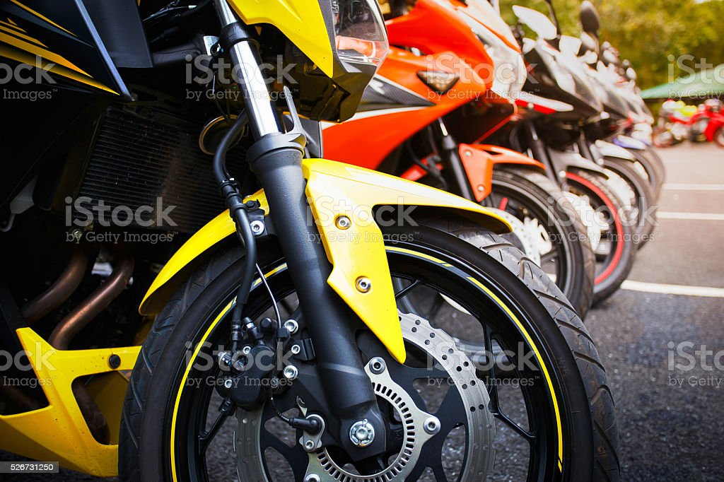 motorcycles standing in the row stock photo