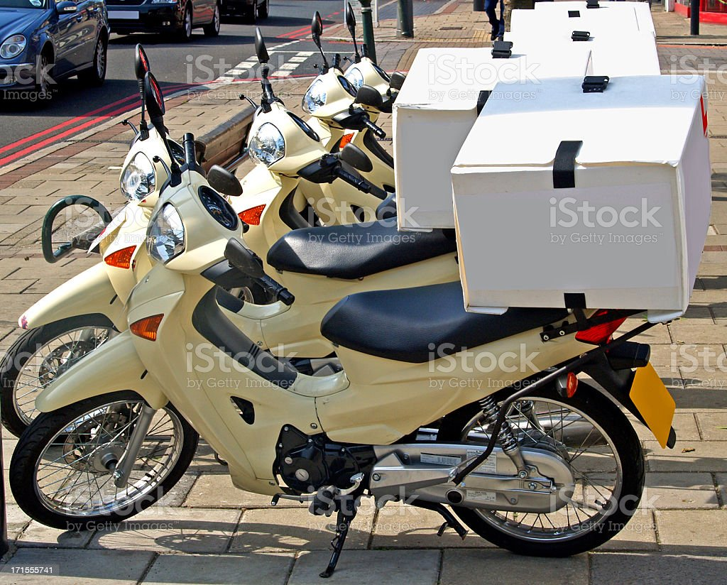 Motorcycles with pizza boxes in back for delivery stock photo