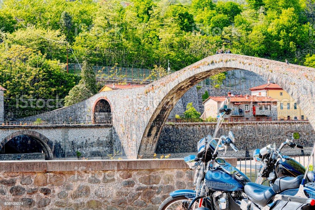 Motorcycling at the Devil's Bridge, Garfagnana, Lucca stock photo