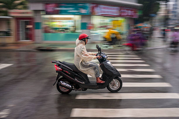 motorcycling in vietnam - motorbike, umbrella stock pictures, royalty-free photos & images