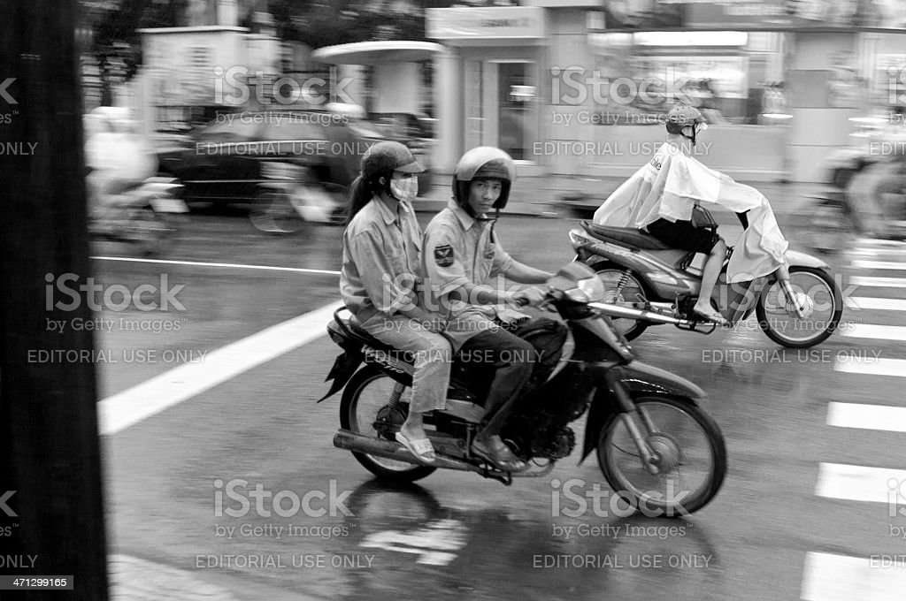 Motorcycling Through A Storm In Vietnam royalty-free stock photo