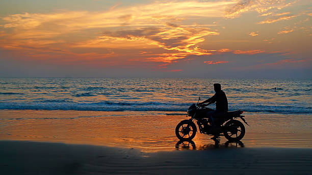 Motorcyclist at sunset on the beach picture id469718093?b=1&k=6&m=469718093&s=612x612&w=0&h=6xxiulefujyib7iomg9 jg2jvsvbbir9psiwltxtkpa=