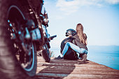 Cute Couple Sit on Wooden Deck and Enjoying the View