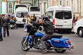 St. Petersburg, Russia - August 03,  2019: Harley-Davidson Motorcycle Festival in St. Petersburg. Bikers ride the show  the Palace Square  and people walking