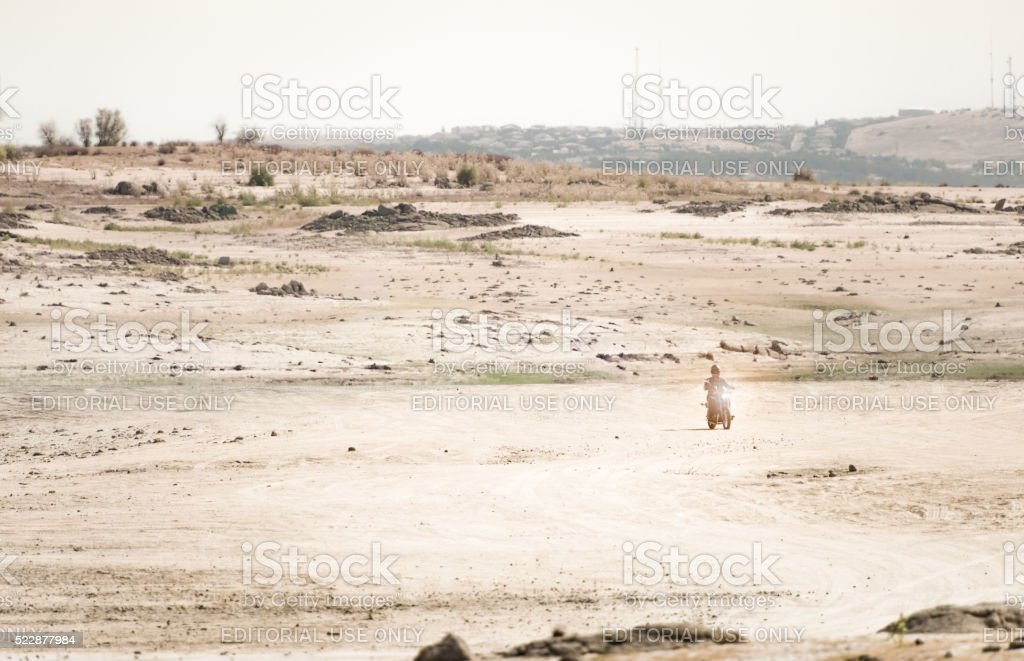 Motorcyclist exploring drought-stricken Folsom Lake stock photo