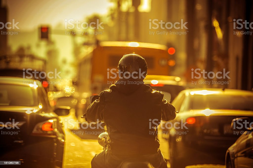 Motorcyclist in Traffic jam stock photo