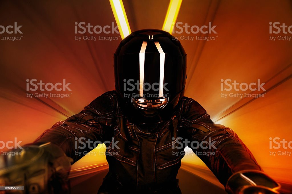 Motorcyclist in Tunnel stock photo
