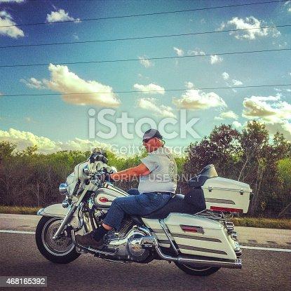 Everglades Parkway, Florida, USA  - January 21, 2015: Motorcyclist moving on a highway, Florida, USA