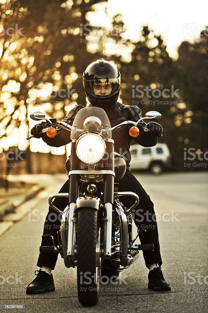 motorcyclist on his cruiser stock photo