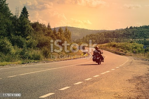 istock Motorcyclist on mountain road, trip to Ukraine in the Carpathian mountains, beautiful landscape with a road, extreme vacation. 1179741930