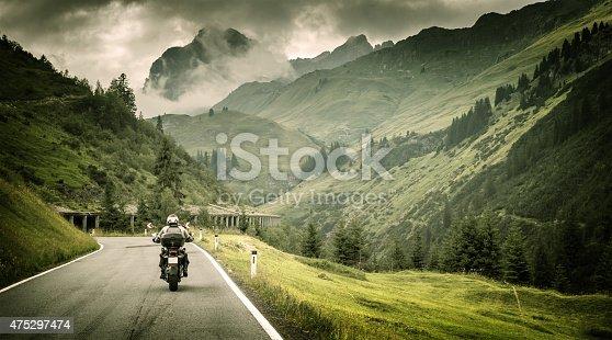 istock Motorcyclist on mountainous highway 475297474