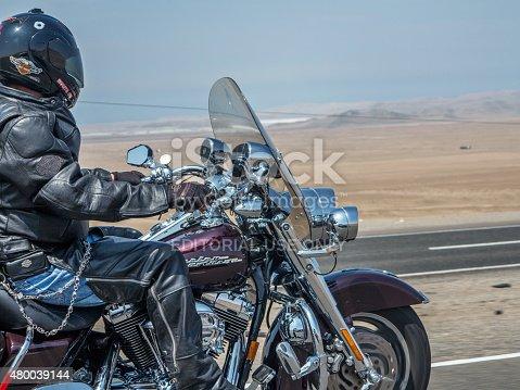 Huaral, Peru - January 22, 2015: Harley Davidson female Motorcyclist on the pan-american highway in Peru
