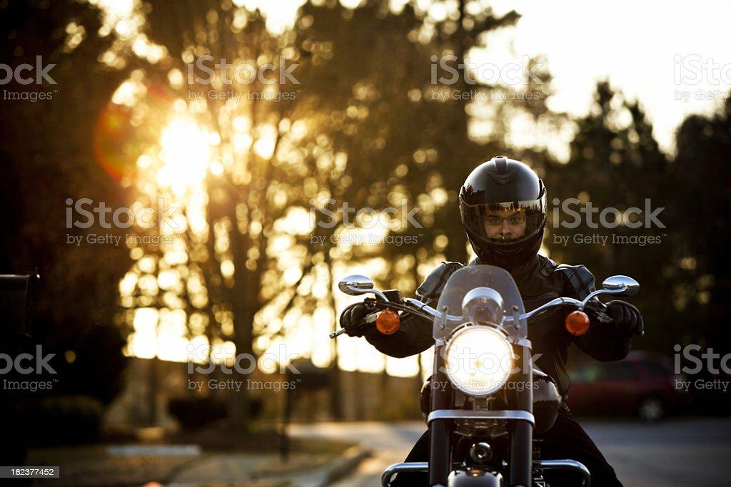 motorcyclist portrait in sunrays stock photo
