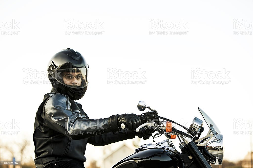 motorcyclist profile on his cuiser stock photo