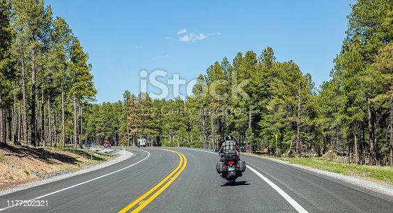 Arizona highway, USA. May 26, 2019: Rear view of a biker riding a moto, highway near Sedona,  blue sky, sunny spring day