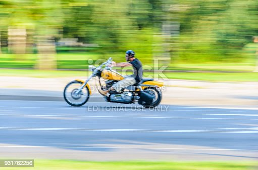 istock Motorcyclist Rides a Yellow Motorcycle 931762256