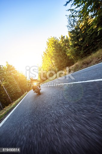 istock Motorcyclist riding  chopper on a road 519493514