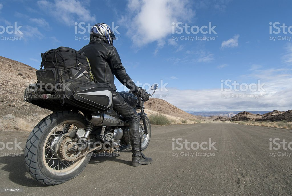 motorcyclist stops to appreciate view stock photo