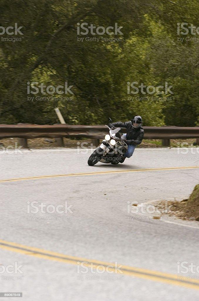 Motorcyclist taking corner stock photo