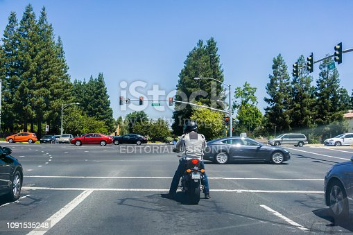July 28, 2017 Sunnyvale/CA/USA - Motorcyclist waiting at a traffic light
