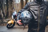 istock Motorcyclist with his helmet 1217689278