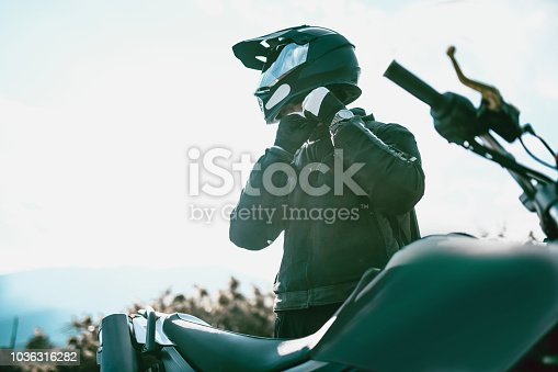 Motorcyclist With Specialized Equipment Getting Ready To Ride